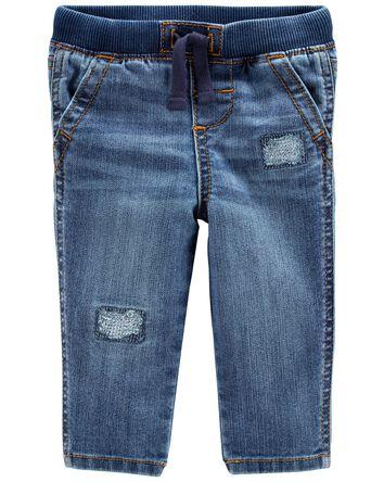 Jeans en denim extensible à pièces