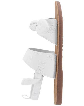 Sandales à œillets et nœuds