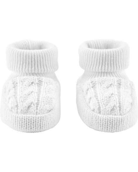 Chaussons en tricot torsadé