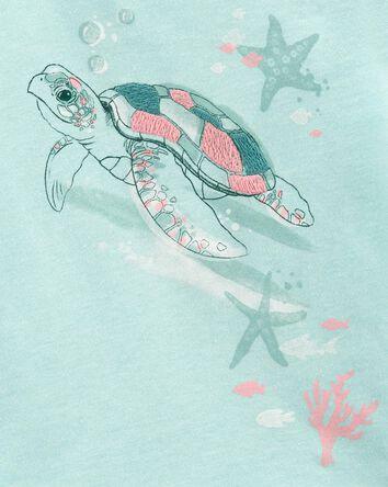 Haut asymétrique à tortue de mer