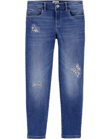 Jeans style déchiré et cousu de cou...
