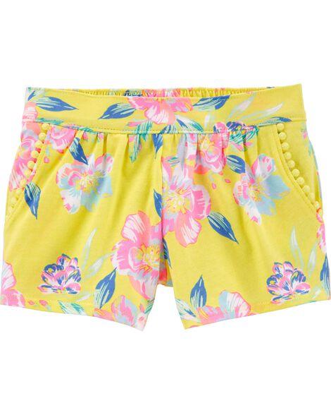 Short à fleurs tropicales avec bordure à pompons